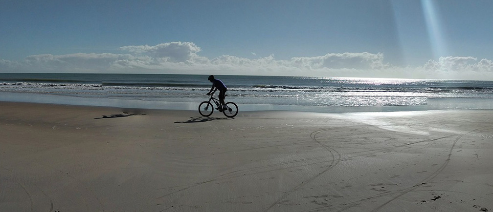 bike safety tips-bike riding ion the beach